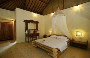 lit en bambou avec moustiquaire