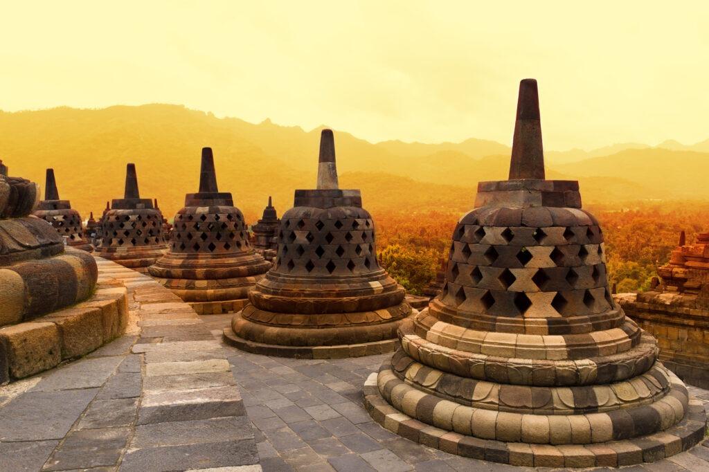 Borobudur Temple at sunset. Ancient stupas of Borobudur Temple.